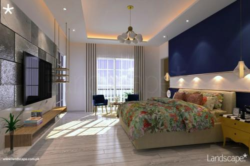 Spacious Planning for a Bedroom showing Tiled LED Wall and Subtle Furniture with Hints of Royal Blue Upholstery and Bed Wall
