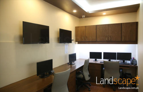 the-settlement-room-desk-with-screens-and-filing-cabinets