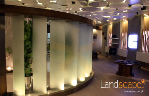 Glass-Panels-Frosted-Displayed-in-a-Creative-Way-Showing-Spot-Lights-and-White-Marble-Crush-Under-and-Between-Spaces