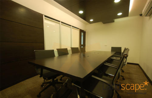 Wooden-drop-panel-hung-over-the-conference-table-in-the-board-room