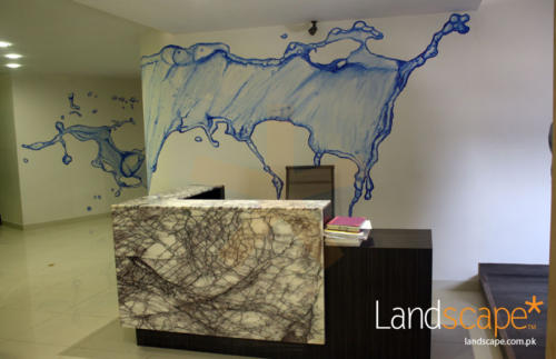 Reception-Desk-with-mural-on-back-wall