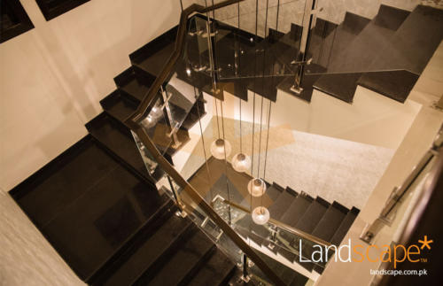 a-closer-view-of-the-long-pendant-lamps-dropping-from-the-roof-ceiling-through-basement