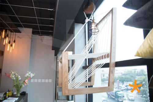 chair-hung-to-the-display-window-with-pulley